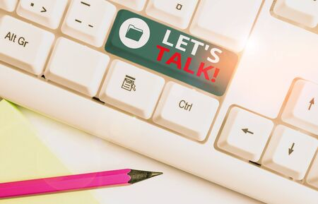Writing note showing Let S Is Talk. Business concept for suggesting in the beginning of a conversation on the topic White pc keyboard with note paper above the white background