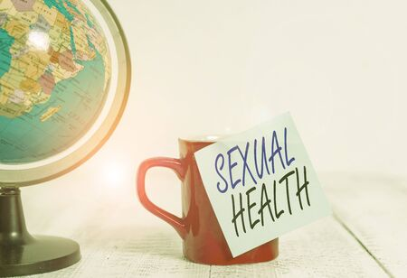 Conceptual hand writing showing Sexual Health. Concept meaning positive and respectful approach to sexual relationships Globe map coffee cup sticky note lying vintage wooden table Archivio Fotografico - 133486833