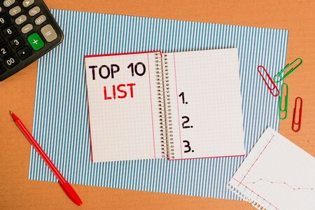Text sign showing Top 10 List. Business photo text the ten most important or successful items in a particular list Striped paperboard notebook cardboard office study supplies chart paper