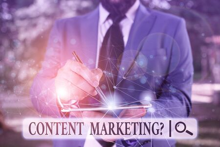 Writing note showing Content Marketing Question. Business concept for involves creation and sharing of online material Male human wear formal suit presenting using smart device Stok Fotoğraf