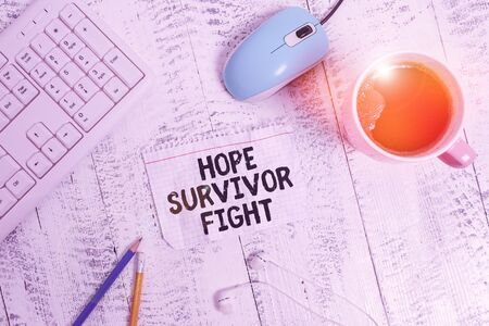 Conceptual hand writing showing Hope Survivor Fight. Concept meaning stand against your illness be fighter stick to dreams Technological devices colored reminder paper office supplies