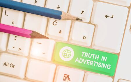 Writing note showing Truth In Advertising. Business concept for Practice Honest Advertisement Publicity Propaganda White pc keyboard with note paper above the white background Banco de Imagens