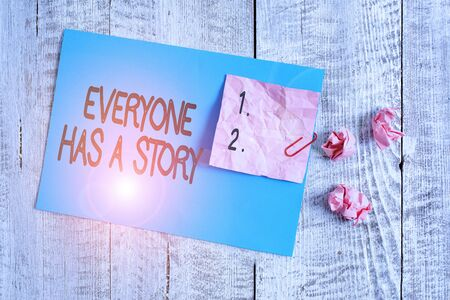 Word writing text Everyone Has A Story. Business photo showcasing Background storytelling telling your memories tales Wrinkle paper and cardboard plus stationary placed above wooden background Stok Fotoğraf