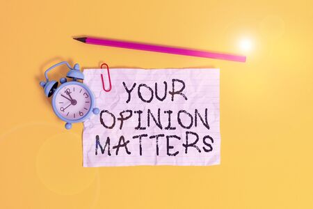 Conceptual hand writing showing Your Opinion Matters. Concept meaning to Have your say Providing a Valuable Input to Improve Metal alarm clock ccrushed sheet pencil colored background