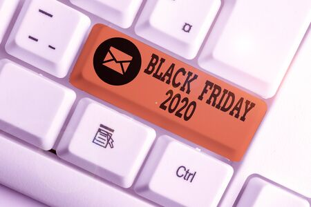 Word writing text Black Friday 2020. Business photo showcasing day following Thanksgiving Discounts Shopping day White pc keyboard with empty note paper above white background key copy space