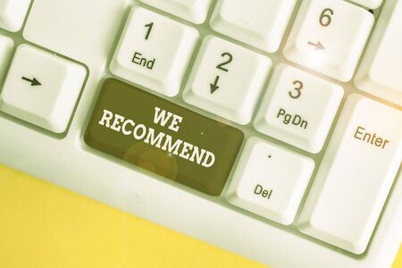 Text sign showing We Recommend. Business photo showcasing suggest that someone or something would be good or suitable White pc keyboard with empty note paper above white background key copy space Stockfoto
