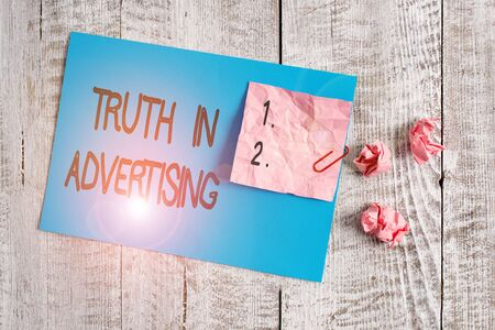 Word writing text Truth In Advertising. Business photo showcasing Practice Honest Advertisement Publicity Propaganda Wrinkle paper and cardboard plus stationary placed above wooden background