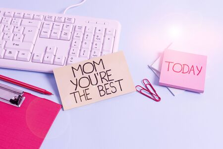 Word writing text Mom You Re The Best. Business photo showcasing Appreciation for your mother love feelings compliment Paper blue desk computer keyboard office study notebook chart numbers memo