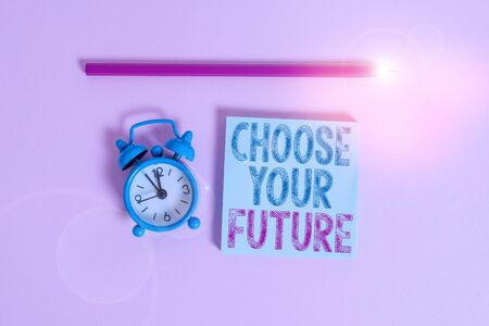 Word writing text Choose Your Future. Business photo showcasing Choices make today will define the outcome of tomorrow Metal vintage alarm clock wakeup blank notepad marker colored background