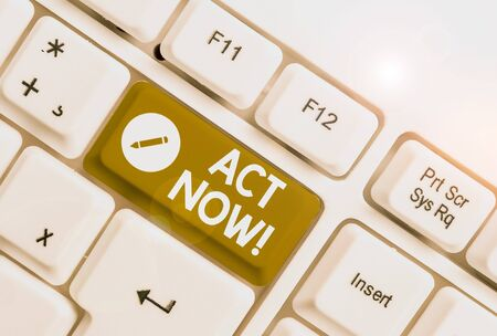 Text sign showing Act Now. Business photo text fulfil the function or serve the purpose of Take action Do something White pc keyboard with empty note paper above white background key copy space