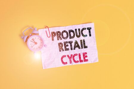 Text sign showing Product Retail Cycle. Business photo showcasing as brand progresses through sequence of stages Metal alarm clock clip blank crushed note sheet colored background