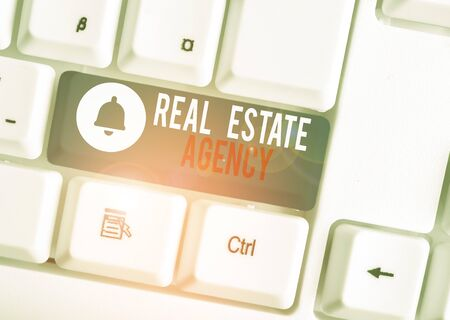 Text sign showing Real Estate Agency. Business photo text Business Entity Arrange Sell Rent Lease Manage Properties White pc keyboard with empty note paper above white background key copy space Stockfoto