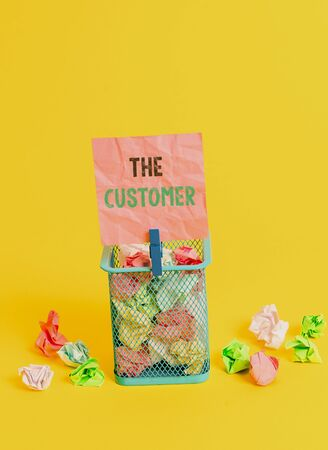 Handwriting text writing The Customer. Conceptual photo demonstrating or organization that buys goods or services from a store Trash bin crumpled paper clothespin empty reminder office supplies yellow
