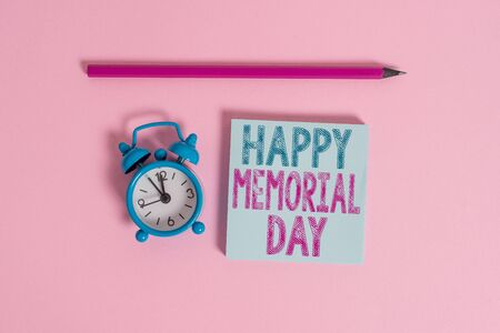 Word writing text Happy Memorial Day. Business photo showcasing Honoring Remembering those who died in military service Metal vintage alarm clock wakeup blank notepad marker colored background 写真素材