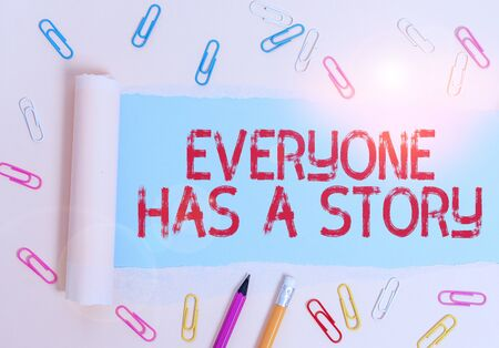 Writing note showing Everyone Has A Story. Business concept for Background storytelling telling your memories tales Stationary and torn cardboard placed above plain pastel table backdrop Stock fotó