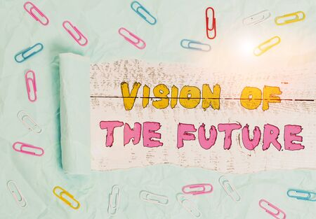Writing note showing Vision Of The Future. Business concept for Seeing something Ahead a Clear Guide of Action Paper clip and torn cardboard on wood classic table backdrop