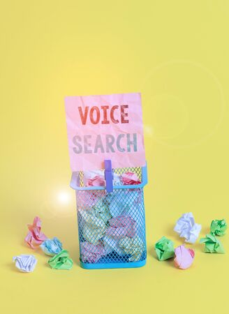 Handwriting text writing Voice Search. Conceptual photo allows the user to use a voice comanalysisd to search the Internet Trash bin crumpled paper clothespin empty reminder office supplies yellow Stok Fotoğraf