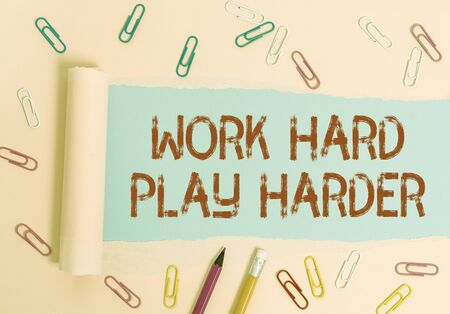 Writing note showing Work Hard Play Harder. Business concept for a Balance Life Have a Break Destressing to Relax Stationary and torn cardboard placed above plain pastel table backdrop