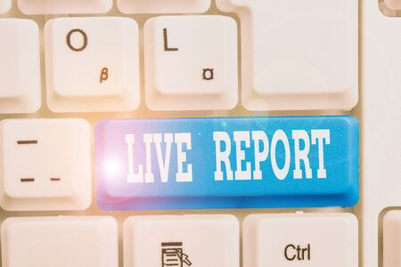 Handwriting text writing Live Report. Conceptual photo continuous stream of updates that are published in real time White pc keyboard with empty note paper above white background key copy space