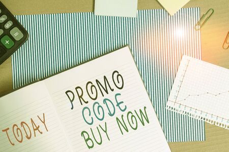 Handwriting text writing Promo Code Buy Now. Conceptual photo Giving great discount by entering special words Striped paperboard notebook cardboard office study supplies chart paper 스톡 콘텐츠