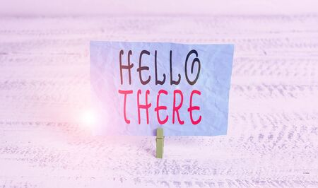 Word writing text Hello There. Business photo showcasing a way to get someone s is attention more strongly upon greeting Green clothespin white wood background colored paper reminder office supply