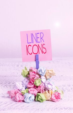 Writing note showing Liner Icons. Business concept for use to improve visual interest and grab the user s is attention Reminder pile colored crumpled paper clothespin wooden space