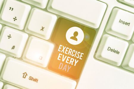 Writing note showing Exercise Every Day. Business concept for move body energetically in order to get fit and healthy White pc keyboard with note paper above the white background