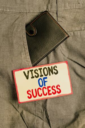 Conceptual hand writing showing Visions Of Success. Concept meaning Clear End Result of Purpose Goal Perspective Plan Small wallet inside trouser front pocket near notation paper