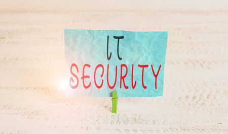 Word writing text It Security. Business photo showcasing protection of data or digital asset against unauthorized access Green clothespin white wood background colored paper reminder office supply Stock fotó