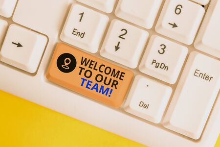 Writing note showing Welcome To Our Team. Business concept for introducing another demonstrating to your team mates White pc keyboard with note paper above the white background 写真素材
