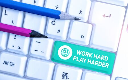Writing note showing Work Hard Play Harder. Business concept for a Balance Life Have a Break Destressing to Relax White pc keyboard with note paper above the white background Stock fotó