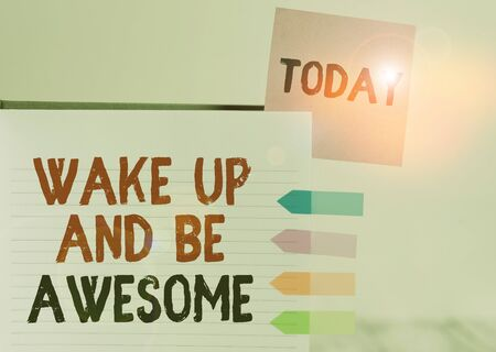 Word writing text Wake Up And Be Awesome. Business photo showcasing Rise up and Shine Start the day Right and Bright Hard cover note book sticky note arrow banners inserted clear background