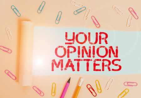 Writing note showing Your Opinion Matters. Business concept for to Have your say Providing a Valuable Input to Improve Stationary and torn cardboard placed above plain pastel table backdrop