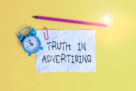 Conceptual hand writing showing Truth In Advertising. Concept meaning Practice Honest Advertisement Publicity Propaganda Metal alarm clock ccrushed sheet pencil colored background