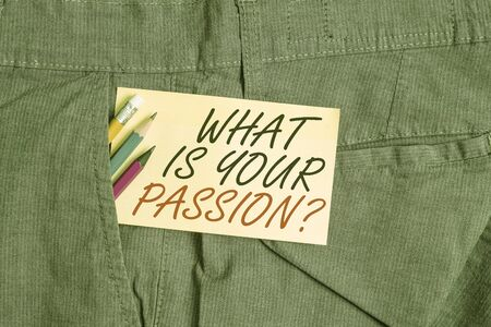 Writing note showing What Is Your Passion Question. Business concept for asking about his strong and barely controllable emotion Writing equipment and yellow note paper inside pocket of man trousers Stock fotó