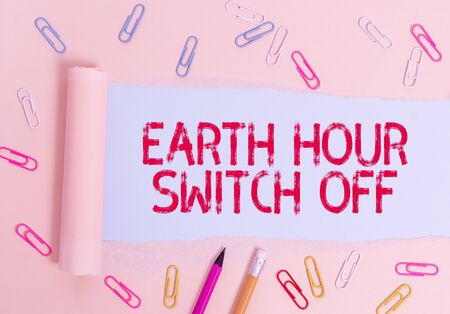 Writing note showing Earth Hour Switch Off. Business concept for The Lights Out Event Annual Movement Planet Day Stationary and torn cardboard placed above plain pastel table backdrop