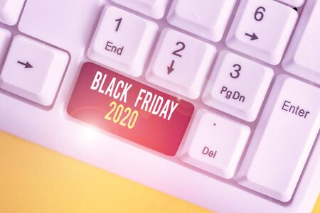 Text sign showing Black Friday 2020. Business photo showcasing day following Thanksgiving Discounts Shopping day White pc keyboard with empty note paper above white background key copy space