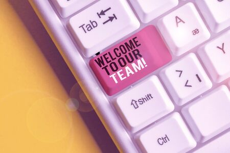 Text sign showing Welcome To Our Team. Business photo text introducing another demonstrating to your team mates White pc keyboard with empty note paper above white background key copy space