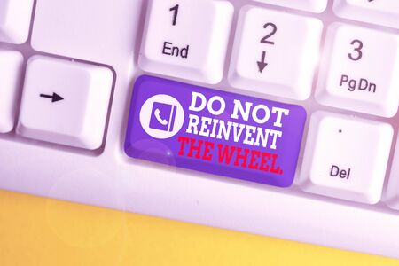 Writing note showing Do Not Reinvent The Wheel. Business concept for stop duplicating a basic method previously done White pc keyboard with note paper above the white background