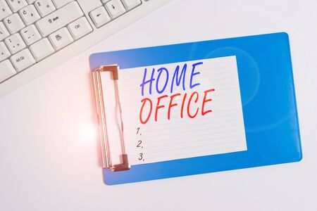 Word writing text Home Office. Business photo showcasing space designated in a demonstrating s is residence for official business Flat lay above table with pc keyboard and copy space note paper