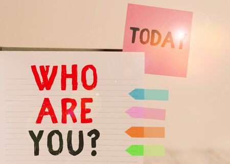 Word writing text Who Are You Question. Business photo showcasing Identify yourself description demonstratingal characteristics Hard cover note book sticky note arrow banners inserted clear background