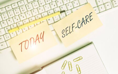 Conceptual hand writing showing Self Care. Concept meaning the practice of taking action to improve one s is own health Empty orange square papers by the pc keyboard with copy space