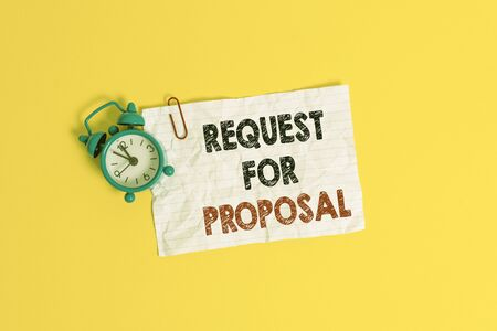 Text sign showing Request For Proposal. Business photo showcasing document contains bidding process by agency or company Metal alarm clock clip blank crushed note sheet colored background