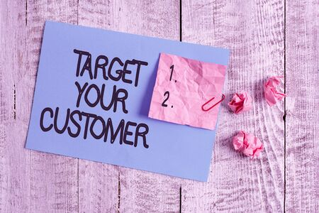 Word writing text Target Your Customer. Business photo showcasing Tailor Marketing Pitch Defining Potential Consumers Wrinkle paper and cardboard plus stationary placed above wooden background