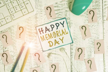Writing note showing Happy Memorial Day. Business concept for Honoring Remembering those who died in military service Writing tools and scribbled paper on top of the wooden table