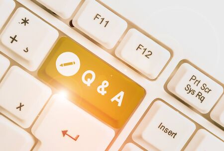 Text sign showing Q And A. Business photo text a period of time or an occasion when someone answers questions White pc keyboard with empty note paper above white background key copy space