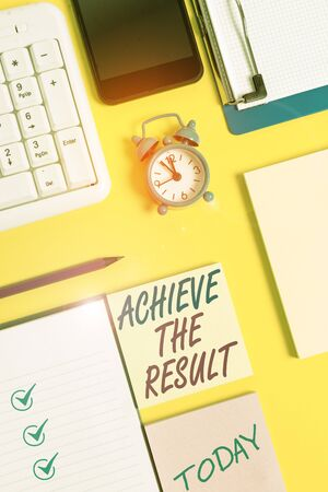 Writing note showing Achieve The Result. Business concept for Receive successful result from hard work make you happy White paper with copy space with paper clips clock and pc keyboard