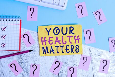 Writing note showing Your Health Matters. Business concept for Physical Wellness is Important Stay Fit and Healthy Writing tools and scribbled paper on top of the wooden table