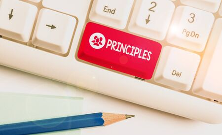 Writing note showing Principles. Business concept for fundamental truth that serves as the base for a system of belief White pc keyboard with note paper above the white background