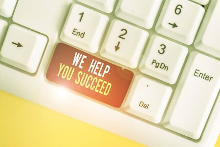Text sign showing We Help You Succeed. Business photo showcasing Aided Supported Funded someone to reach his dreams White pc keyboard with empty note paper above white background key copy space